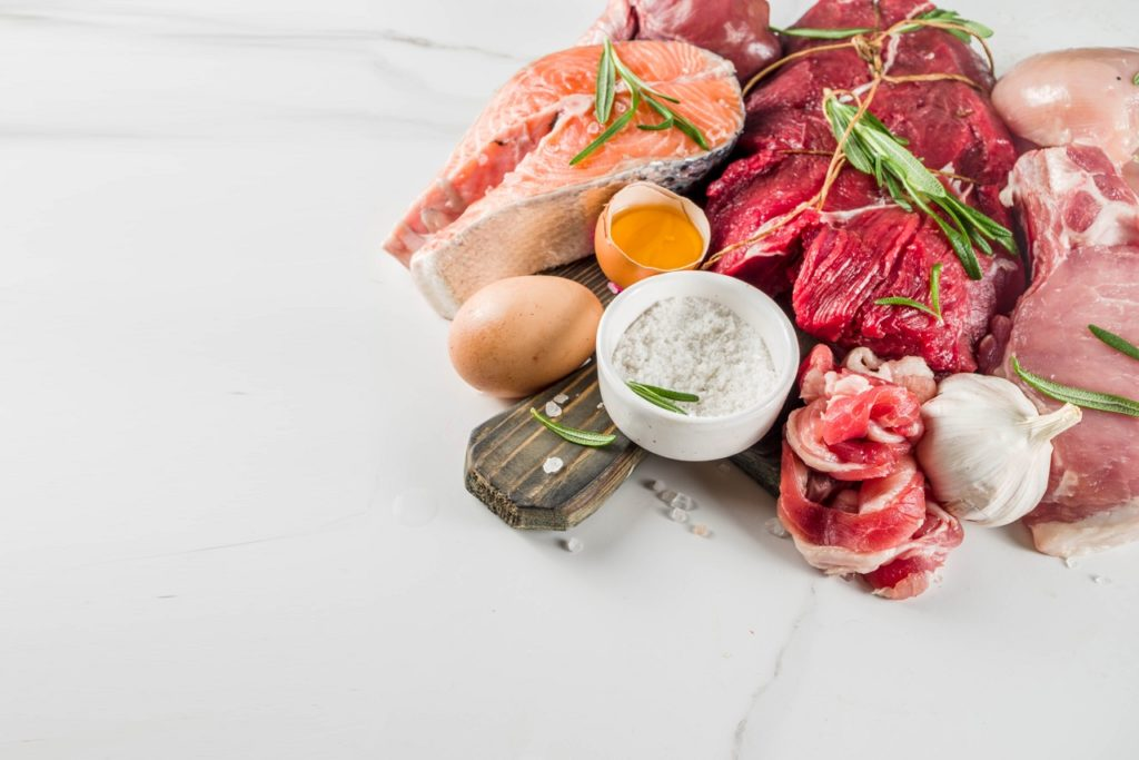 Different types of meat sprawled on a table