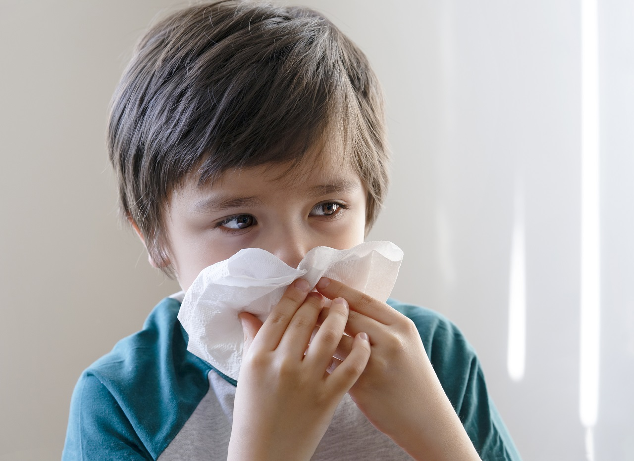 A kid sick with a cold