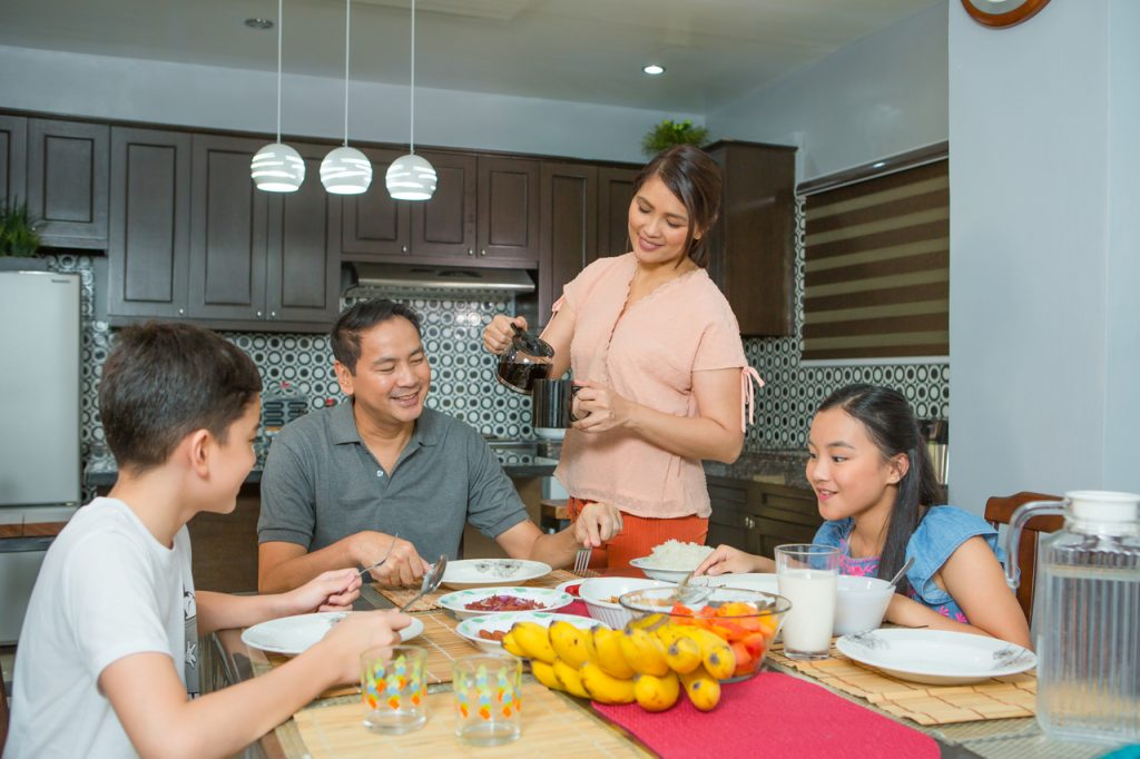 A family eating at a dining table