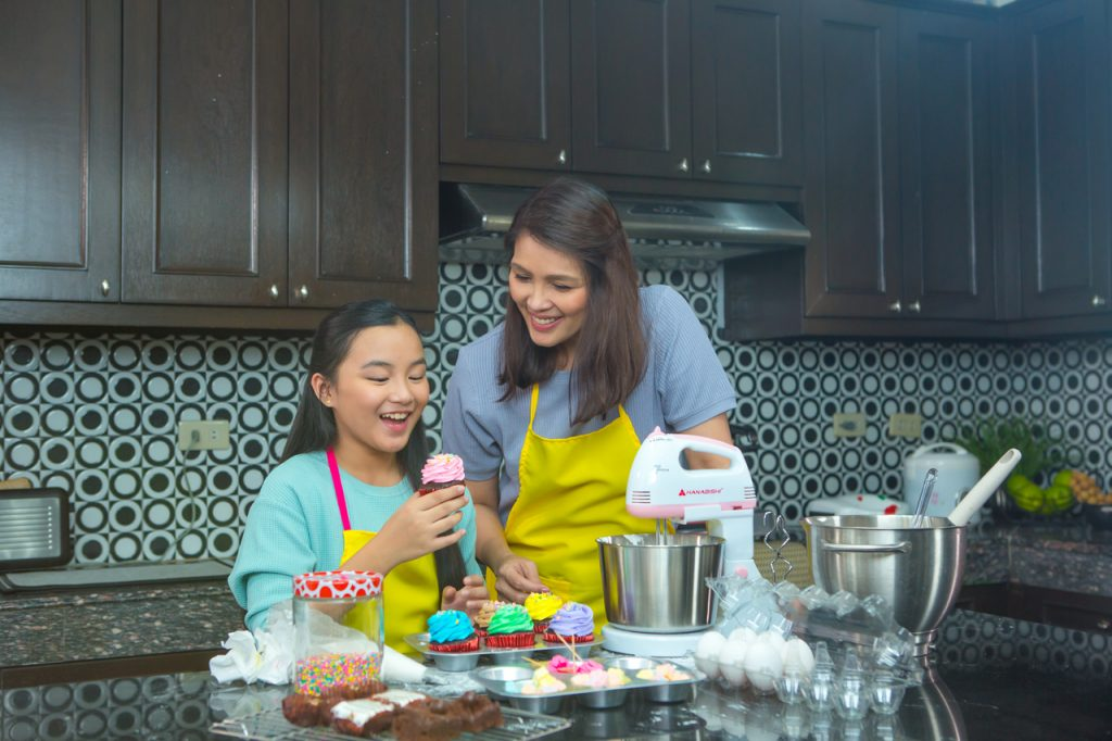A mother and daughter baking