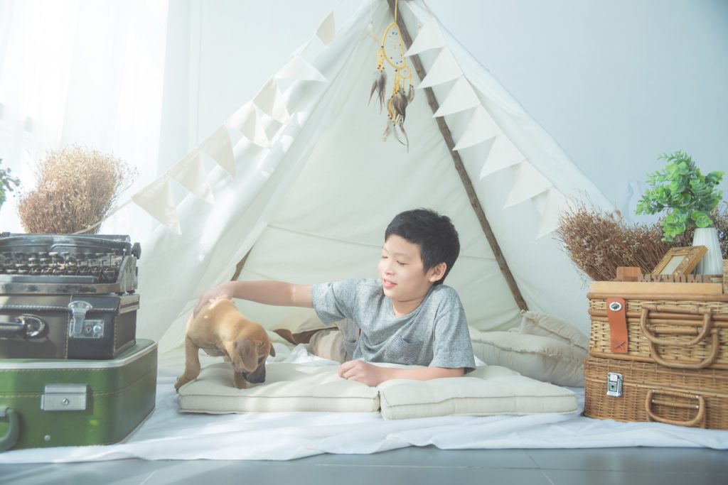 A young boy going indoor camping