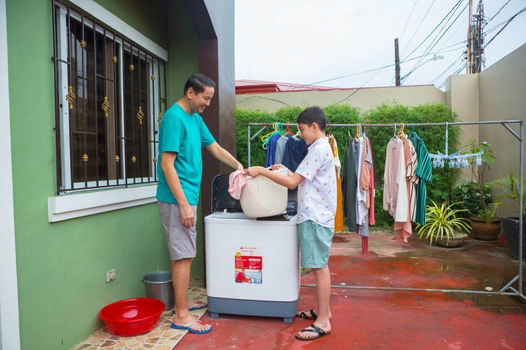 Father and son doing the laundry